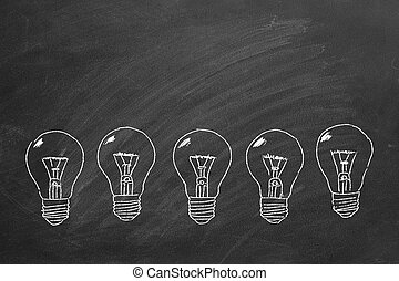 Row of light bulbs chalk drawing on blackboard.
