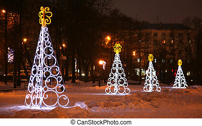 Nizhny Novgorod, Russia - December 16, 2014: ?entral Gorky square decorated light Christmas trees before the New Year and Merry Christmas. Many people like to walk here.