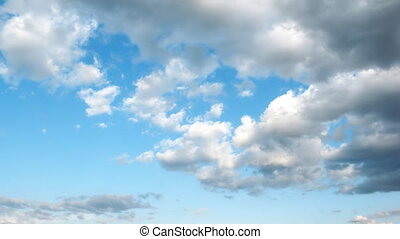 Light cirrus clouds in the blue sky