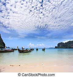 Light cirrus clouds over the warm sea. Picturesque native...