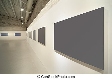 light clean empty exhibition hall with frames for pictures ...