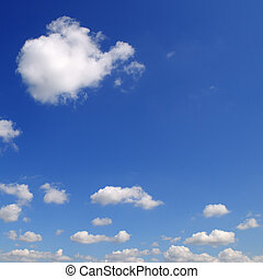 Light clouds in the blue sky. A bright sunny day.