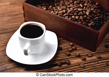 light coffee beans wooden box with coffee, natural wooden background