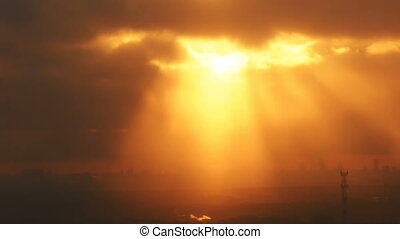 Light coming through dense clouds at sunset - Light coming...