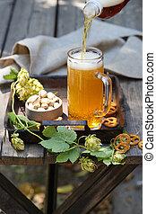 light craft beer in a glass mug