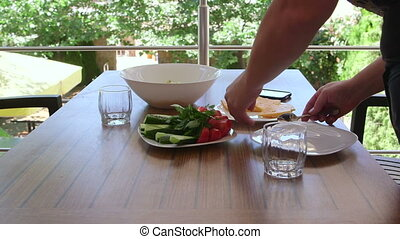 Light dinner on the patio terrace in sunny summer day