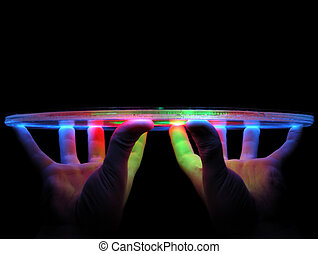 Light Display - Hands holding up a colorful sound activated...