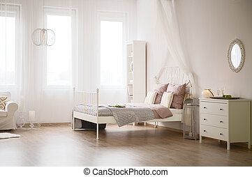 Light flat with bed, dresser, bookcase and sofa