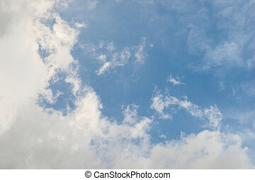 Light fluffy white cloud against blue sky