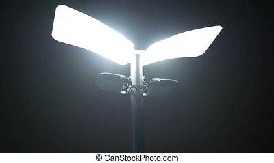 Light foggy night lantern - Ground light in foggy night with...