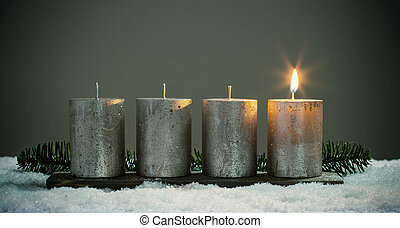 Light four advents candles with matches