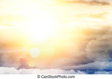 Light from above, bright sun, blue sky and clouds
