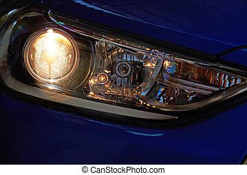 Light from modern car optic. Bright light from car headlight