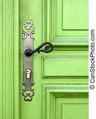 light green door with metal handle