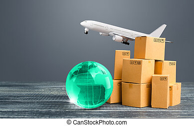 Light green globe near cardboard boxes and freight plane. International delivery of goods and products. Logistics, infrastructure hubs. Import, export. Economic relations commerce. Air transportation