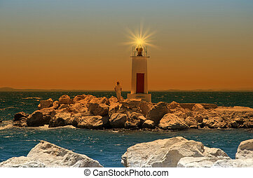 A man standing next to a small light house after sunset