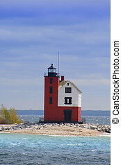 Historic light house at Round island in the middle of lake Huron