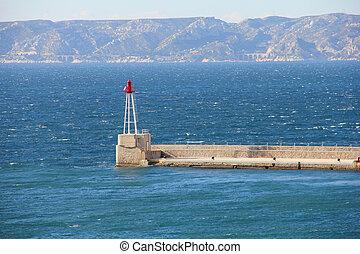 Light house in the blue ocean