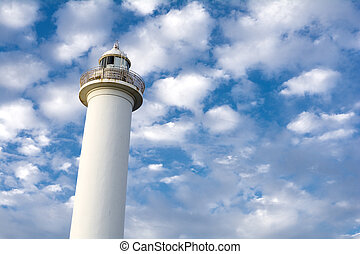 Light house - White light house under clouds flowing blue...