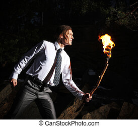 Light in darkness - Image of brave man with burning stick...