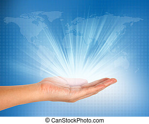 light in hand on blue technology background