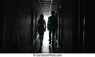 Light in the Tunnel - Camera following two unrecognizable...