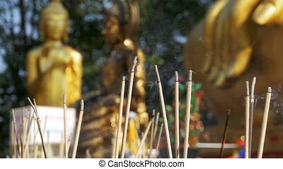 Light Incense Sticks with Smoke in Buddhist Temple....