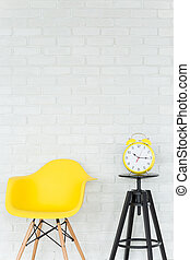 Light interior with energetic yellow details - Yellow chair...