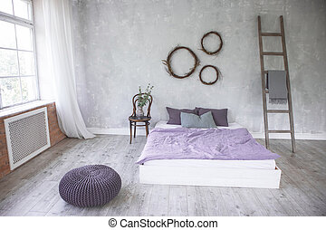 light loft style bedroom interior,design made in gray and purple colors with modern furniture and big windows,ladder next to white bed.
