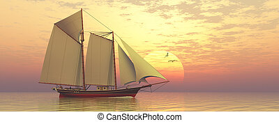 Light of the Sun - Sunset captures a sailing schooner as she...