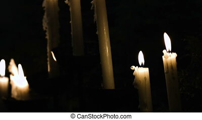 Light of white Candle flames on a black background