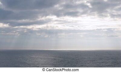 Light pass through clouds at sea, time lapse