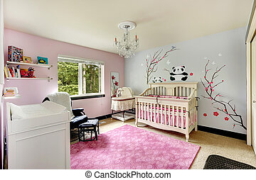 Light pink and blue nursery room with crib