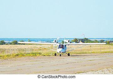 Light plane on the runway