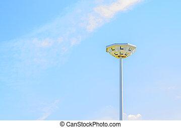 Light pole in the blue sky