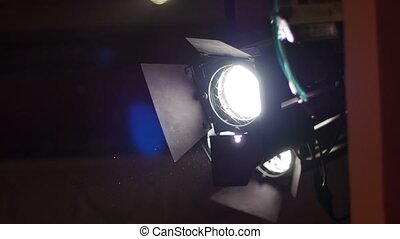 A light projector at the theater and dust particles seen in the light beam.