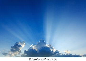light rays explosion on clear blue sky with cloud