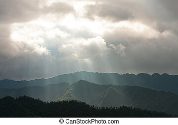Light rays over mountain landscape