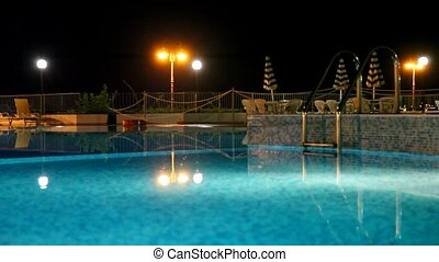 Light reflected from the lamp, turn the water in the pool at...