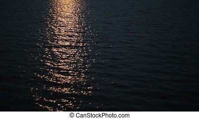 Light reflections in the water at night