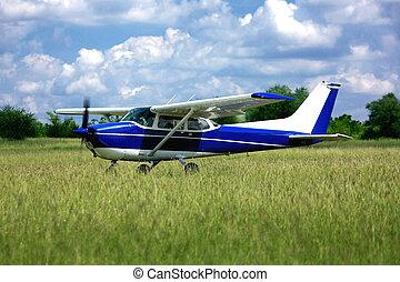 Light school airplane on grass