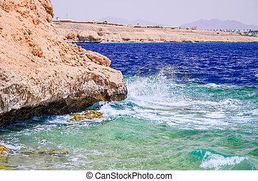 Light sea surf during the hot wind. Egypt, Sharm El Sheikh.