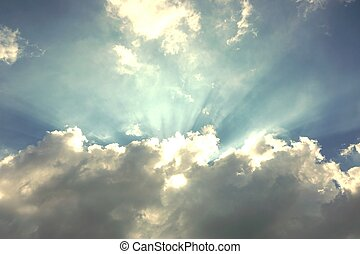 Light shines through the clouds