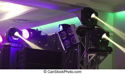light show, laser show. Stage lights on a console, Lighting the concert stage, entertainment concert lighting on stage
