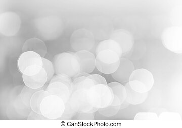 Light silver abstract Christmas background with glowing...