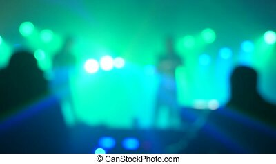 light spotlight concert retro music concert pop band blurred background. slow motion video. two girls singer singing into lifestyle a microphone