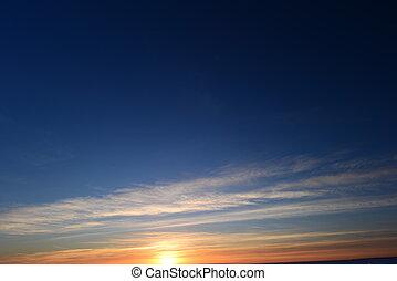 Light sunset twilight in clear blue winter sky