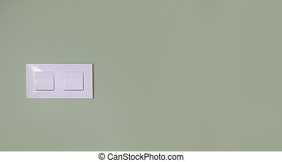 Light switch on a green wall
