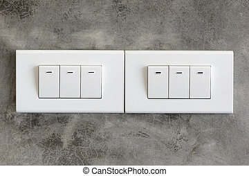 Light switch on cement wall background