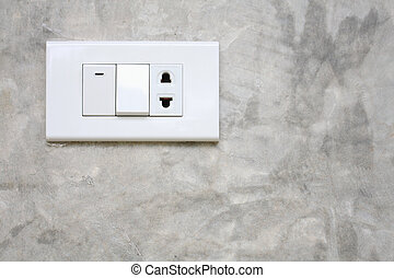 Light switch on the wall cement